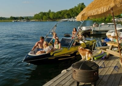Boat Docked with People and Dog