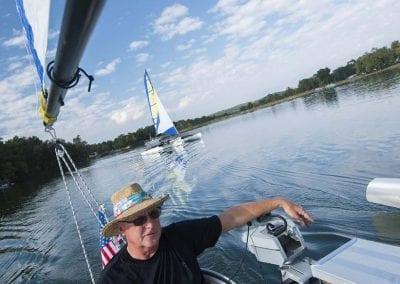 Man Saling on Lake