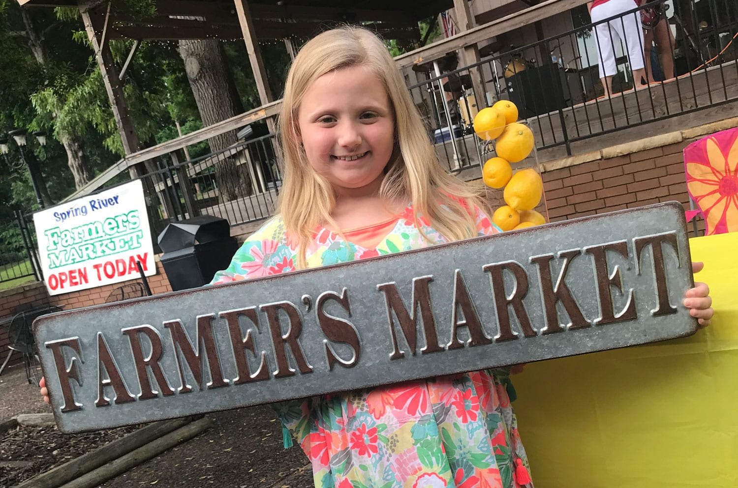 Little Girl Holding a Rustic Farmer's Market Sign